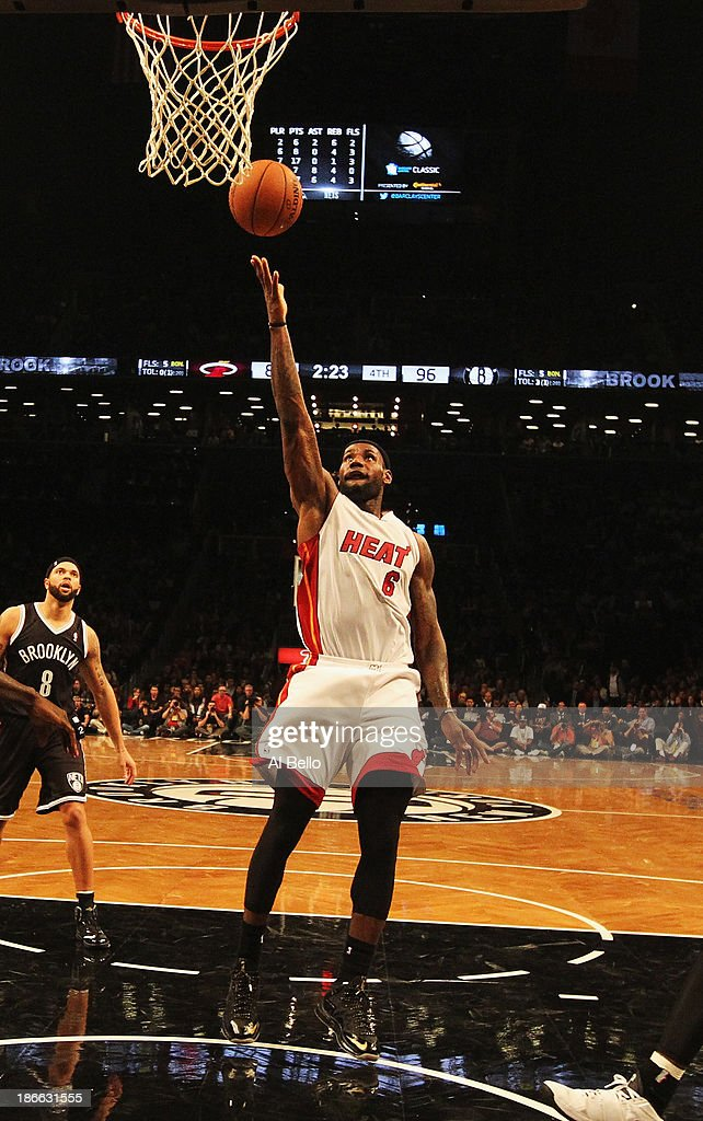 <a gi-track='captionPersonalityLinkClicked' href=/galleries/search?phrase=LeBron+James&family=editorial&specificpeople=201474 ng-click='$event.stopPropagation()'>LeBron James</a> #6 of the Miami Heat scores against the Brooklyn Nets during their game at the Barclays Center on November 1, 2013 in the Brooklyn borough of New York City.