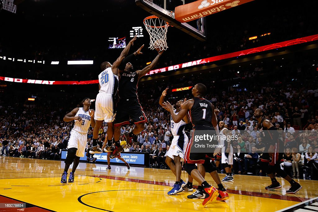 LeBron James #6 of the Miami Heat scores with a driving layup with 3.2 seconds left in the fourth quarter past DeQuan Jones #20 of the Orlando Magic at American Airlines Arena on March 6, 2013 in Miami, Florida. The Heat defeated the Orlando Magic 97-96.