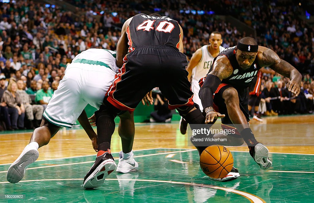 LeBron James #6 of the Miami Heat scrambles for the loose ball against the Boston Celtics during the game on January 27, 2013 at TD Garden in Boston, Massachusetts.