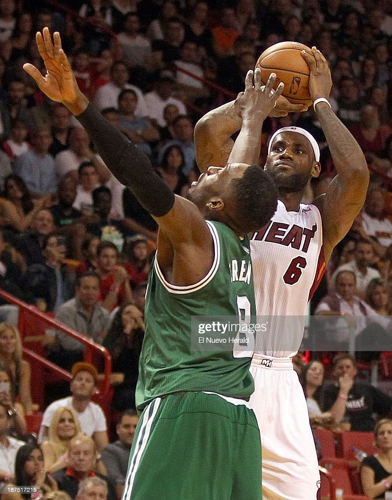 LeBron James of the Miami Heat shoots a basket over Jeff Green of the Boston Celtics during the fourth quarter at the AmericanAirlines Arena in Miami on Saturday, Nov. 9, 2013.