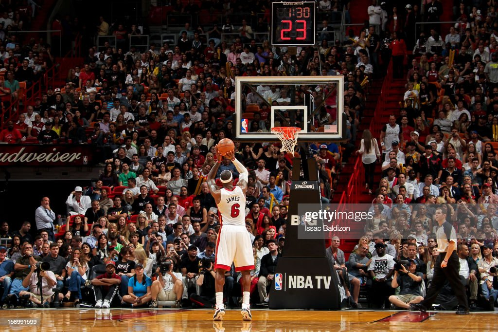 <a gi-track='captionPersonalityLinkClicked' href=/galleries/search?phrase=LeBron+James&family=editorial&specificpeople=201474 ng-click='$event.stopPropagation()'>LeBron James</a> #6 of the Miami Heat shoots a free-throw against the Chicago Bulls on January 4, 2013 at American Airlines Arena in Miami, Florida.