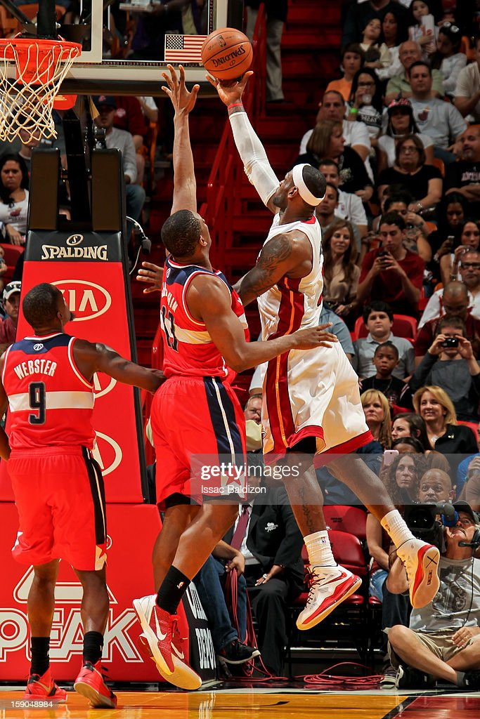 <a gi-track='captionPersonalityLinkClicked' href=/galleries/search?phrase=LeBron+James&family=editorial&specificpeople=201474 ng-click='$event.stopPropagation()'>LeBron James</a> #6 of the Miami Heat shoots a layup against <a gi-track='captionPersonalityLinkClicked' href=/galleries/search?phrase=Kevin+Seraphin&family=editorial&specificpeople=6474998 ng-click='$event.stopPropagation()'>Kevin Seraphin</a> #13 of the Washington Wizards on January 6, 2013 at American Airlines Arena in Miami, Florida.