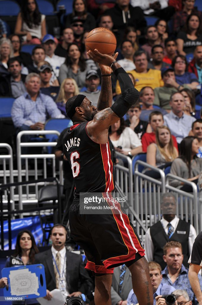LeBron James #6 of the Miami Heat shoots a three point shot against the Orlando Magic during the game on December 31, 2012 at Amway Center in Orlando, Florida.