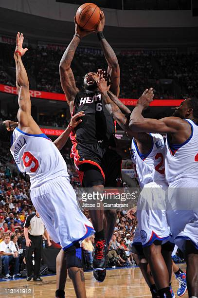 LeBron James of the Miami Heat shoots against Andre Iguodala and Lou Williams of the Philadelphia 76ers in Game Four of the Eastern Conference...