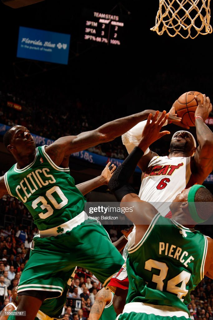 LeBron James #6 of the Miami Heat shoots against (L-R) Brandon Bass #30 and Paul Pierce #34 of the Boston Celtics during the NBA game on October 30, 2012 at American Airlines Arena in Miami, Florida.