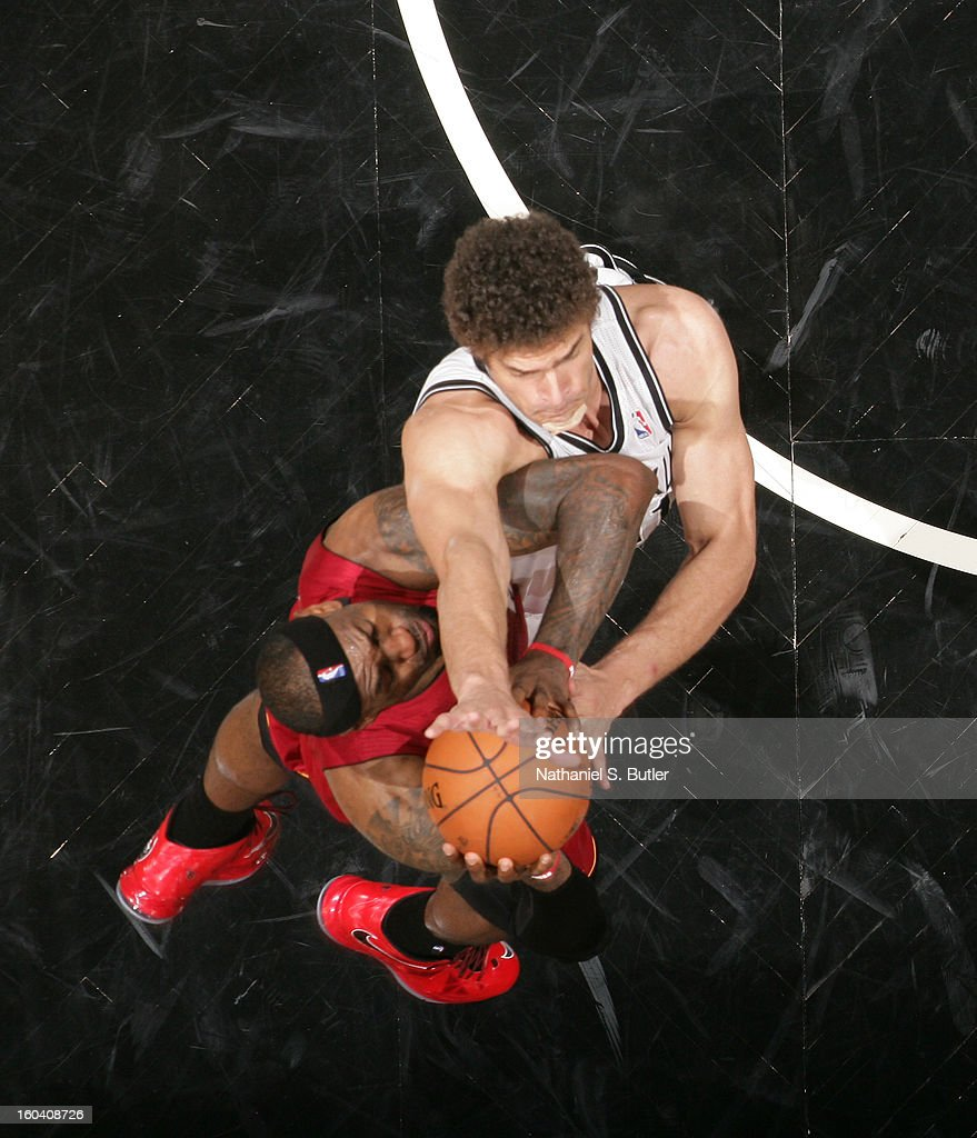 <a gi-track='captionPersonalityLinkClicked' href=/galleries/search?phrase=LeBron+James&family=editorial&specificpeople=201474 ng-click='$event.stopPropagation()'>LeBron James</a> #6 of the Miami Heat shoots against <a gi-track='captionPersonalityLinkClicked' href=/galleries/search?phrase=Brook+Lopez&family=editorial&specificpeople=3847328 ng-click='$event.stopPropagation()'>Brook Lopez</a> #11 of the Brooklyn Nets on January 30, 2013 at the Barclays Center in the Brooklyn borough of New York City.