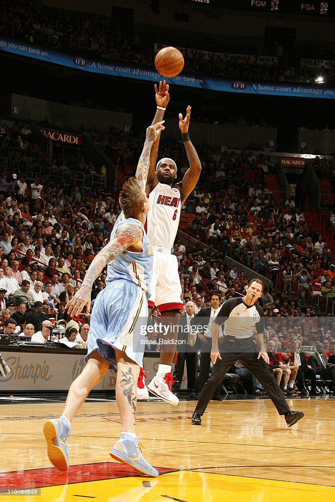 <a gi-track='captionPersonalityLinkClicked' href=/galleries/search?phrase=LeBron+James&family=editorial&specificpeople=201474 ng-click='$event.stopPropagation()'>LeBron James</a> #6 of the Miami Heat shoots against Chris Andersen #11 of the Denver Nuggets on March 19, 2011 at American Airlines Arena in Miami, Florida.