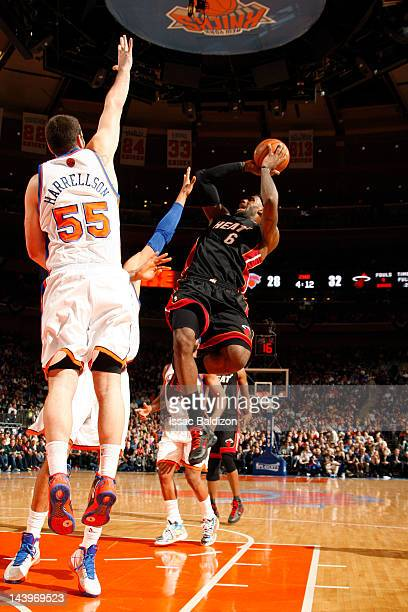 LeBron James of the Miami Heat shoots against Josh Harrellson of the New York Knicks in Game Four of the Eastern Conference Quarterfinals during the...
