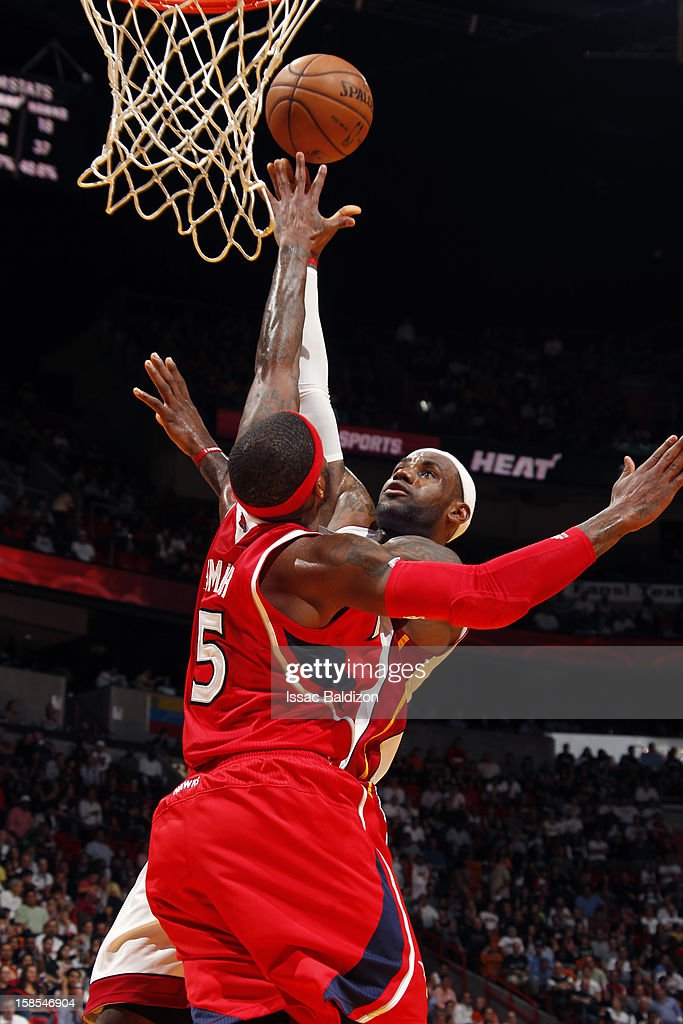 LeBron James #6 of the Miami Heat shoots against Josh Smith #5 of the Atlanta Hawks on December 10, 2012 at American Airlines Arena in Miami, Florida.