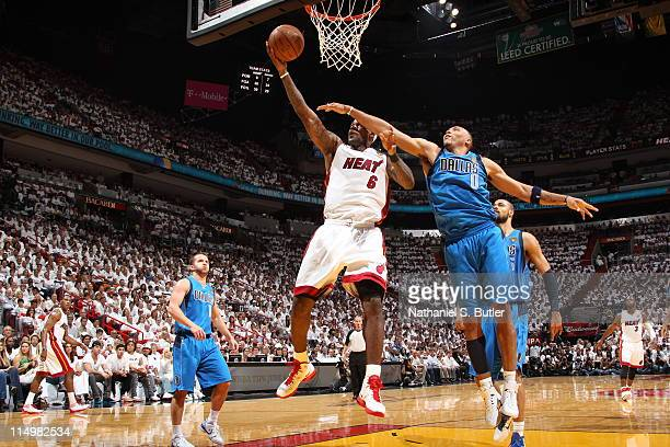 LeBron James of the Miami Heat shoots against Shawn Marion of the Dallas Mavericks during Game One of the 2011 NBA Finals on May 31 2011 at the...