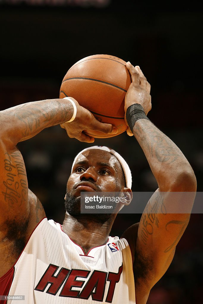 <a gi-track='captionPersonalityLinkClicked' href=/galleries/search?phrase=LeBron+James&family=editorial&specificpeople=201474 ng-click='$event.stopPropagation()'>LeBron James</a> #6 of the Miami Heat shoots against the Denver Nuggets on March 19, 2011 at American Airlines Arena in Miami, Florida.