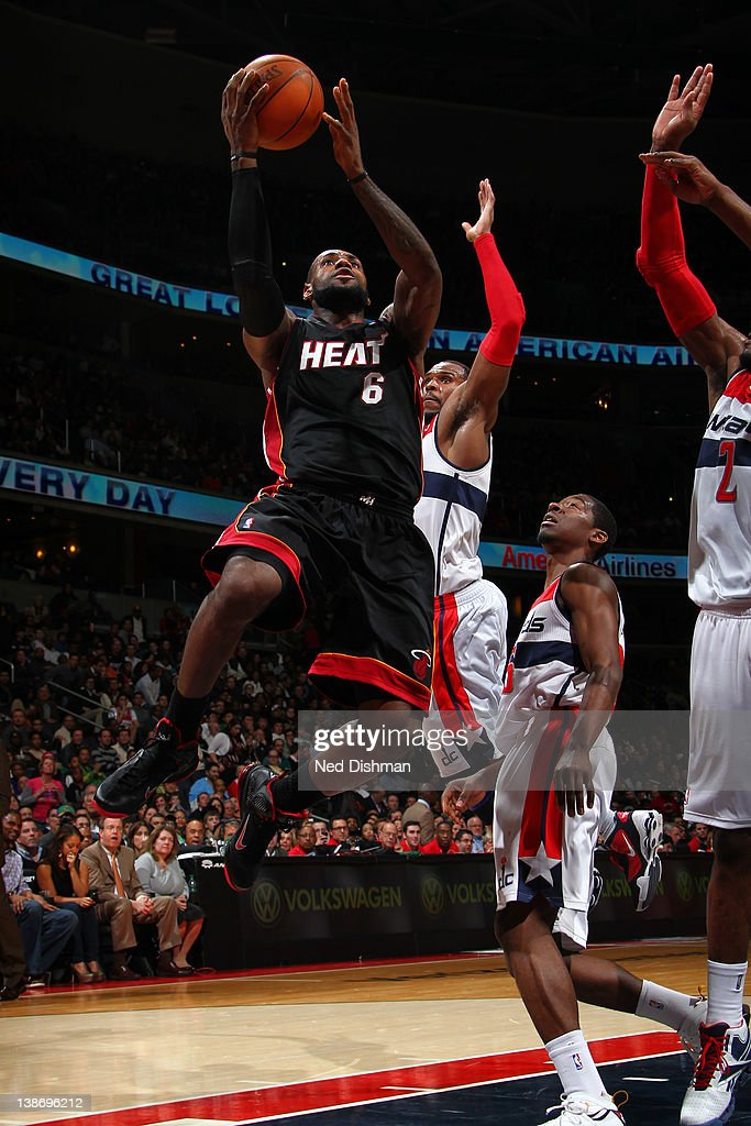 <a gi-track='captionPersonalityLinkClicked' href=/galleries/search?phrase=LeBron+James&family=editorial&specificpeople=201474 ng-click='$event.stopPropagation()'>LeBron James</a> #6 of the Miami Heat shoots against Trevor Booker #35 and John Wall #2 of the Washington Wizards during the game at the Verizon Center on February 10, 2012 in Washington, DC.