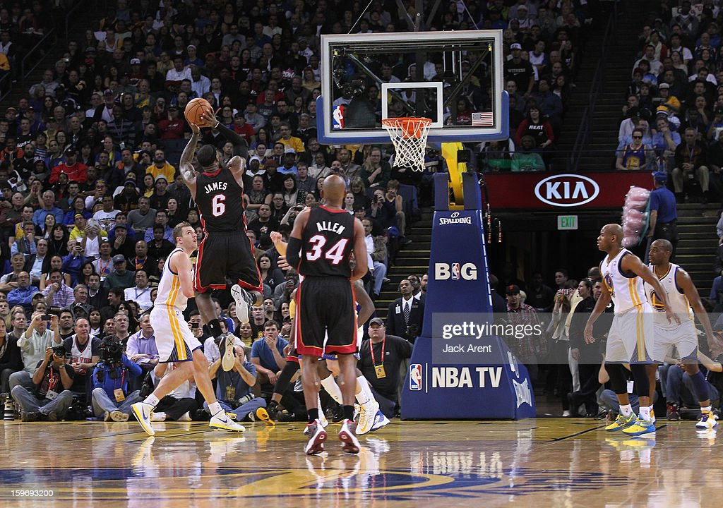 Lebron James #6 of the Miami Heat shoots and makes the basket to become the youngest player ever to reach 20,000 points, while playing against the Golden State Warriors on January 16, 2013 at Oracle Arena in Oakland, California.