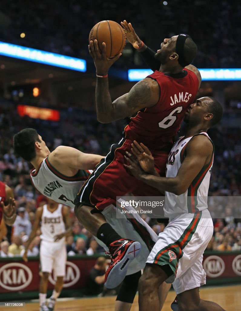 <a gi-track='captionPersonalityLinkClicked' href=/galleries/search?phrase=LeBron+James&family=editorial&specificpeople=201474 ng-click='$event.stopPropagation()'>LeBron James</a> #6 of the Miami Heat shoots between Ersan Ilyasova #2 and <a gi-track='captionPersonalityLinkClicked' href=/galleries/search?phrase=Luc+Richard+Mbah+a+Moute&family=editorial&specificpeople=699041 ng-click='$event.stopPropagation()'>Luc Richard Mbah a Moute</a> #12 of the Milwaukee Bucks in Game Four of the Eastern Conference Quarterfinals during the 2013 NBA Playoffs at the Bradley Center on April 28, 2013 in Milwaukee, Wisconsin.