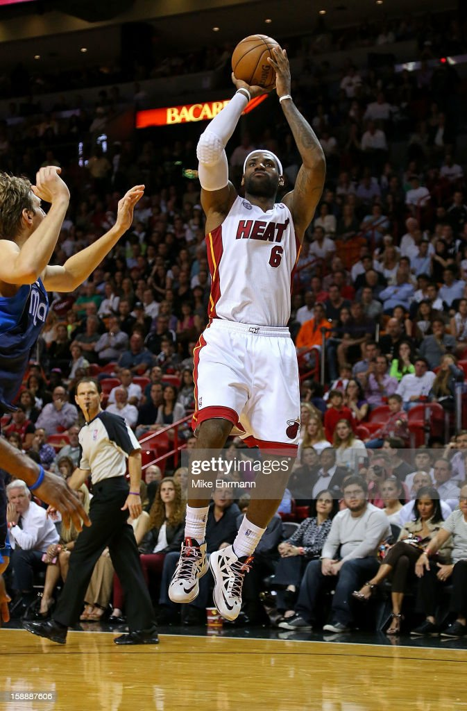 LeBron James #6 of the Miami Heat shoots during a game against the Dallas Mavericks at American Airlines Arena on January 2, 2013 in Miami, Florida.