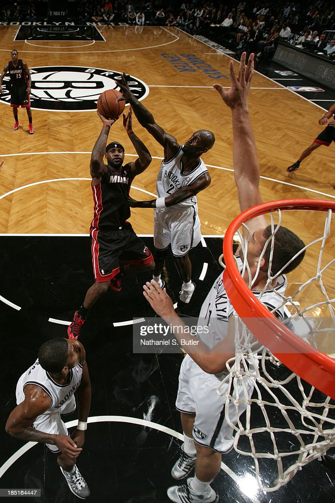 <a gi-track='captionPersonalityLinkClicked' href=/galleries/search?phrase=LeBron+James&family=editorial&specificpeople=201474 ng-click='$event.stopPropagation()'>LeBron James</a> #6 of the Miami Heat shoots during a preseason game against the Brooklyn Nets at the Barclays Center on October 17, 2013 in the Brooklyn borough of New York City.
