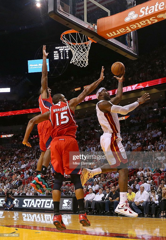 LeBron James #6 of the Miami Heat shoots over Al Horford #15 of the Atlanta Hawks during a game at American Airlines Arena on December 10, 2012 in Miami, Florida.
