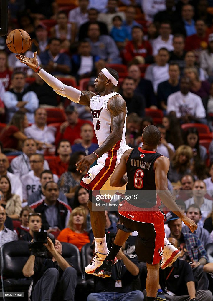 LeBron James #6 of the Miami Heat shoots over Alan Anderson #6 of the Toronto Raptors during a game at American Airlines Arena on January 23, 2013 in Miami, Florida.