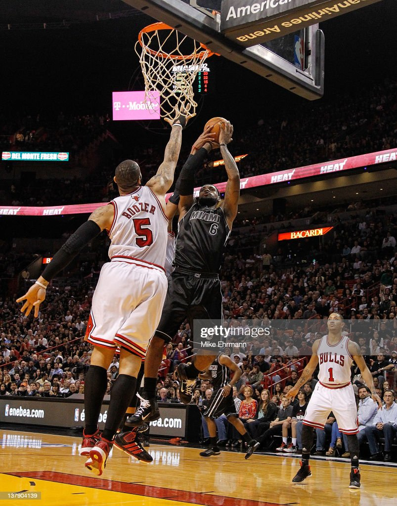 <a gi-track='captionPersonalityLinkClicked' href=/galleries/search?phrase=LeBron+James&family=editorial&specificpeople=201474 ng-click='$event.stopPropagation()'>LeBron James</a> #6 of the Miami Heat shoots over <a gi-track='captionPersonalityLinkClicked' href=/galleries/search?phrase=Carlos+Boozer&family=editorial&specificpeople=201638 ng-click='$event.stopPropagation()'>Carlos Boozer</a> #5 of the Chicago Bulls during a game at American Airlines Arena on January 29, 2012 in Miami, Florida.