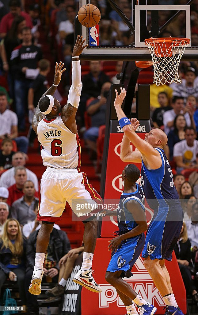 LeBron James #6 of the Miami Heat shoots over Chris Kaman #35 of the Dallas Mavericks during a game at American Airlines Arena on January 2, 2013 in Miami, Florida.