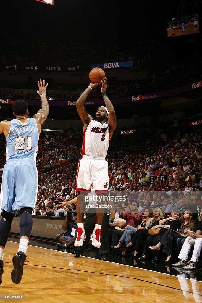 <a gi-track='captionPersonalityLinkClicked' href=/galleries/search?phrase=LeBron+James&family=editorial&specificpeople=201474 ng-click='$event.stopPropagation()'>LeBron James</a> #6 of the Miami Heat shoots over <a gi-track='captionPersonalityLinkClicked' href=/galleries/search?phrase=Wilson+Chandler&family=editorial&specificpeople=809324 ng-click='$event.stopPropagation()'>Wilson Chandler</a> #21 of the Denver Nuggets on March 19, 2011 at American Airlines Arena in Miami, Florida.
