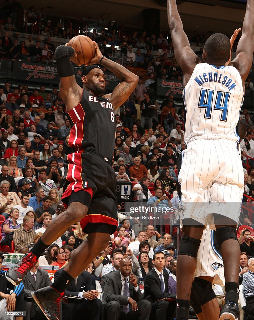 LeBron James #6 of the Miami Heat shoots passes the ball against Andrew Nicholson #44 of the Orlando Magic during the game between the Orlando Magic and the Miami Heat on March 6, 2013 at American Airlines Arena in Miami, Florida.
