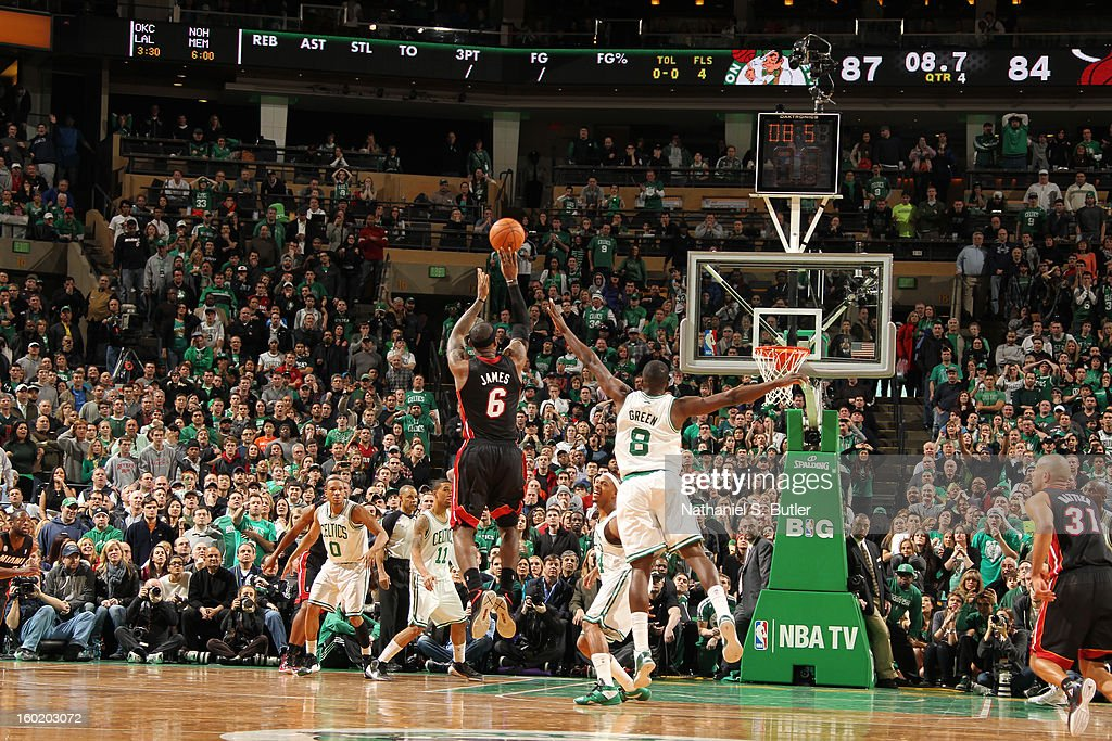 LeBron James #6 of the Miami Heat shoots the game tying three pointer, as time winds down in the 4th quarter, against Jeff Green #8 of the Boston Celtics to put the game into overtime on January 27, 2013 at TD Garden in Boston, Massachusetts.