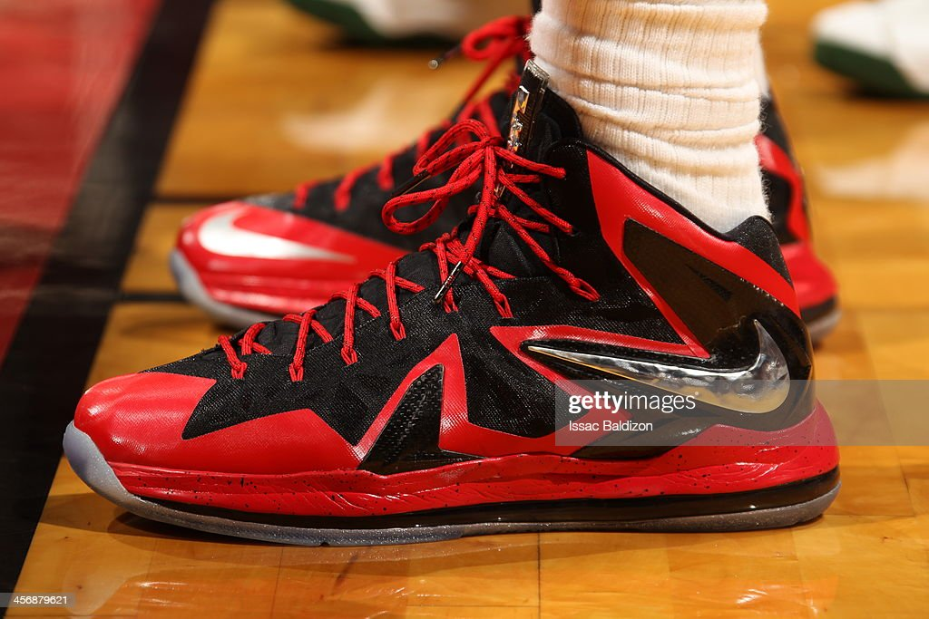 <a gi-track='captionPersonalityLinkClicked' href=/galleries/search?phrase=LeBron+James&family=editorial&specificpeople=201474 ng-click='$event.stopPropagation()'>LeBron James</a> #6 of the Miami Heat showcases his sneakers against the Boston Celtics on November 9, 2013 at American Airlines Arena in Miami, Florida.