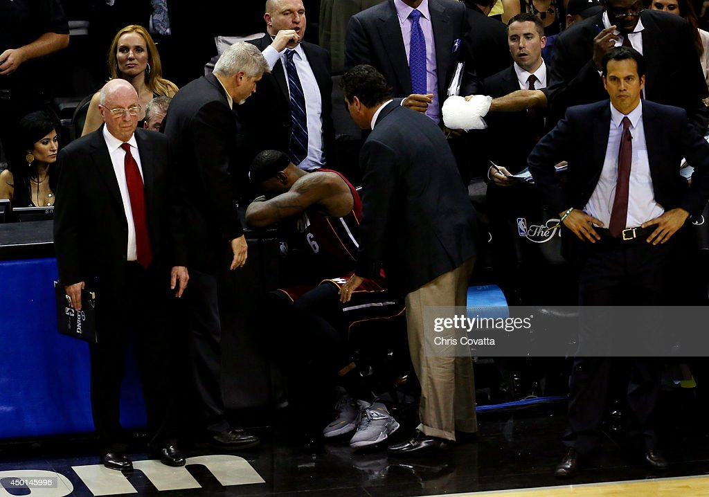 <a gi-track='captionPersonalityLinkClicked' href=/galleries/search?phrase=LeBron+James&family=editorial&specificpeople=201474 ng-click='$event.stopPropagation()'>LeBron James</a> #6 of the Miami Heat sits on the bench after leaving the game in the fourth quarter with cramps against the San Antonio Spurs during Game One of the 2014 NBA Finals at the AT&T Center on June 5, 2014 in San Antonio, Texas.