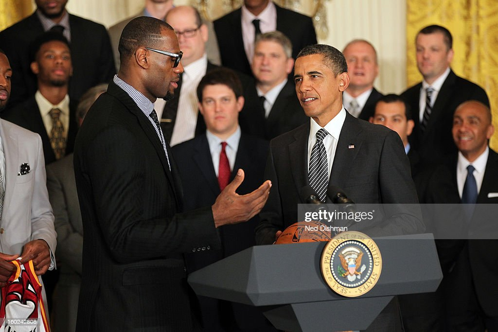<a gi-track='captionPersonalityLinkClicked' href=/galleries/search?phrase=LeBron+James&family=editorial&specificpeople=201474 ng-click='$event.stopPropagation()'>LeBron James</a> #6 of the Miami Heat speaks to President <a gi-track='captionPersonalityLinkClicked' href=/galleries/search?phrase=Barack+Obama&family=editorial&specificpeople=203260 ng-click='$event.stopPropagation()'>Barack Obama</a> during a visit by the Miami Heat to the White House to commemorate the 2012 NBA Champions on January 28, 2013 in Washington, DC.