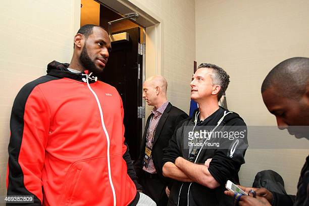 LeBron James of the Miami Heat speaks with sports analyst Bill Simmons during the NBAE Circuit as part of 2014 AllStar Weekend at the Hyatt Regency...