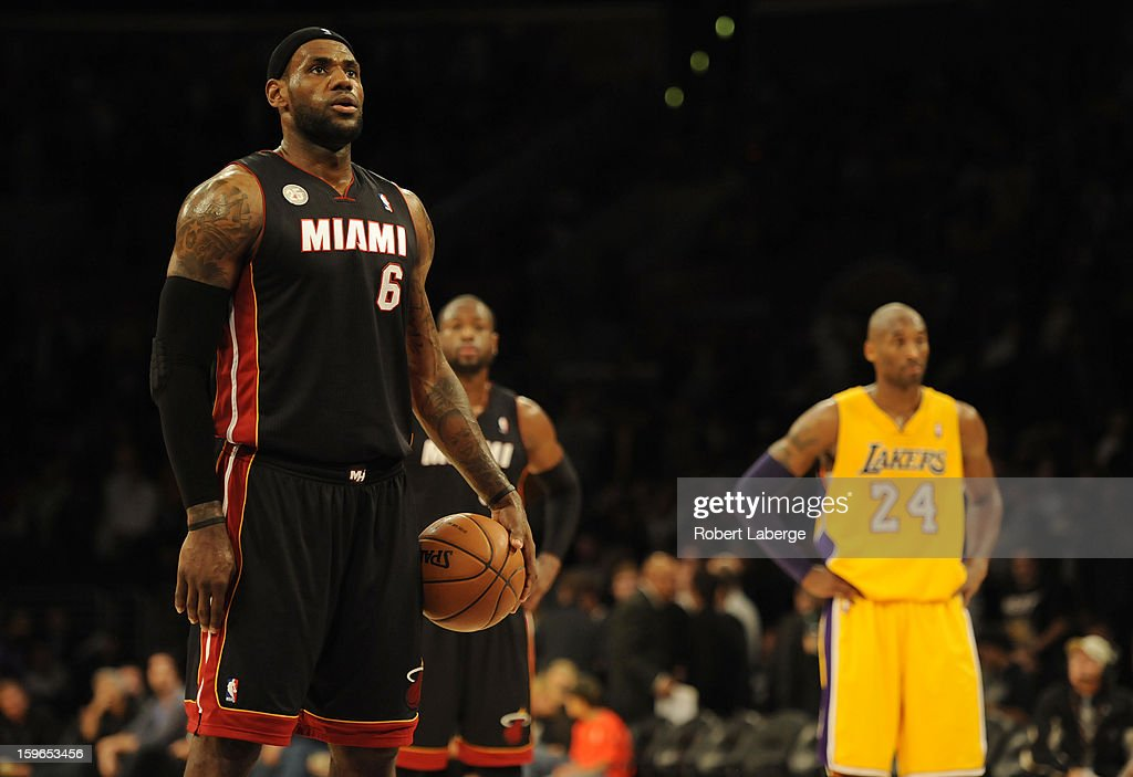 Lebron James #6 of the Miami Heat stands at the free throw line as Dwyane Wade #3 of the Heat and Kobe Bryant #24 of the Los Angeles Lakers stand in the background at Staples Center on January 17, 2013 in Los Angeles, California.