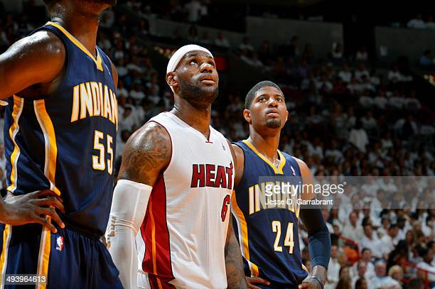 LeBron James of the Miami Heat stands on the court during a game against Paul George of the Indiana Pacers in Game Three of the Eastern Conference...