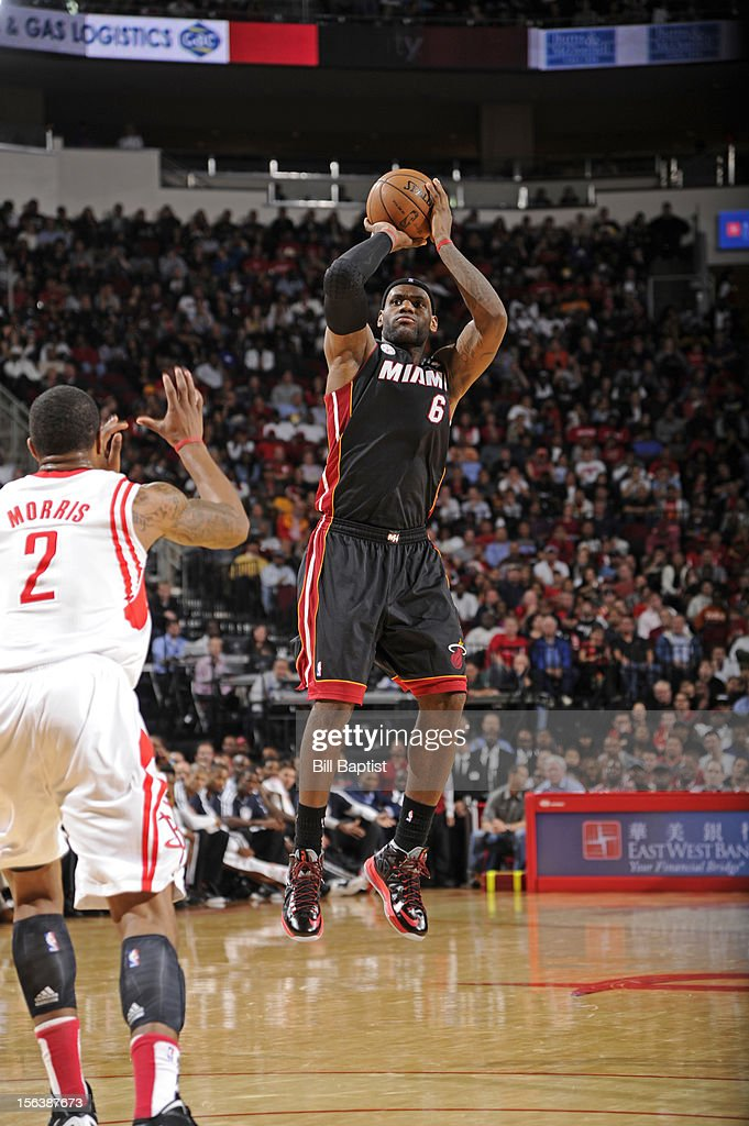 LeBron James #6 of the Miami Heat takes a shot against Marcus Morris #2 of the Houston Rockets on November 12, 2012 at the Toyota Center in Houston, Texas.