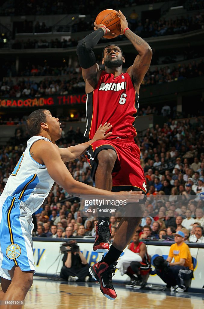 <a gi-track='captionPersonalityLinkClicked' href=/galleries/search?phrase=LeBron+James&family=editorial&specificpeople=201474 ng-click='$event.stopPropagation()'>LeBron James</a> #6 of the Miami Heat takes a shot over <a gi-track='captionPersonalityLinkClicked' href=/galleries/search?phrase=Andre+Miller&family=editorial&specificpeople=201678 ng-click='$event.stopPropagation()'>Andre Miller</a> #24 of the Denver Nuggets at the Pepsi Center on January 13, 2012 in Denver, Colorado.