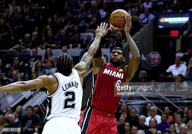 LeBron James of the Miami Heat takes a shot over Kawhi Leonard of the San Antonio Spurs during Game One of the 2014 NBA Finals at the ATT Center on...