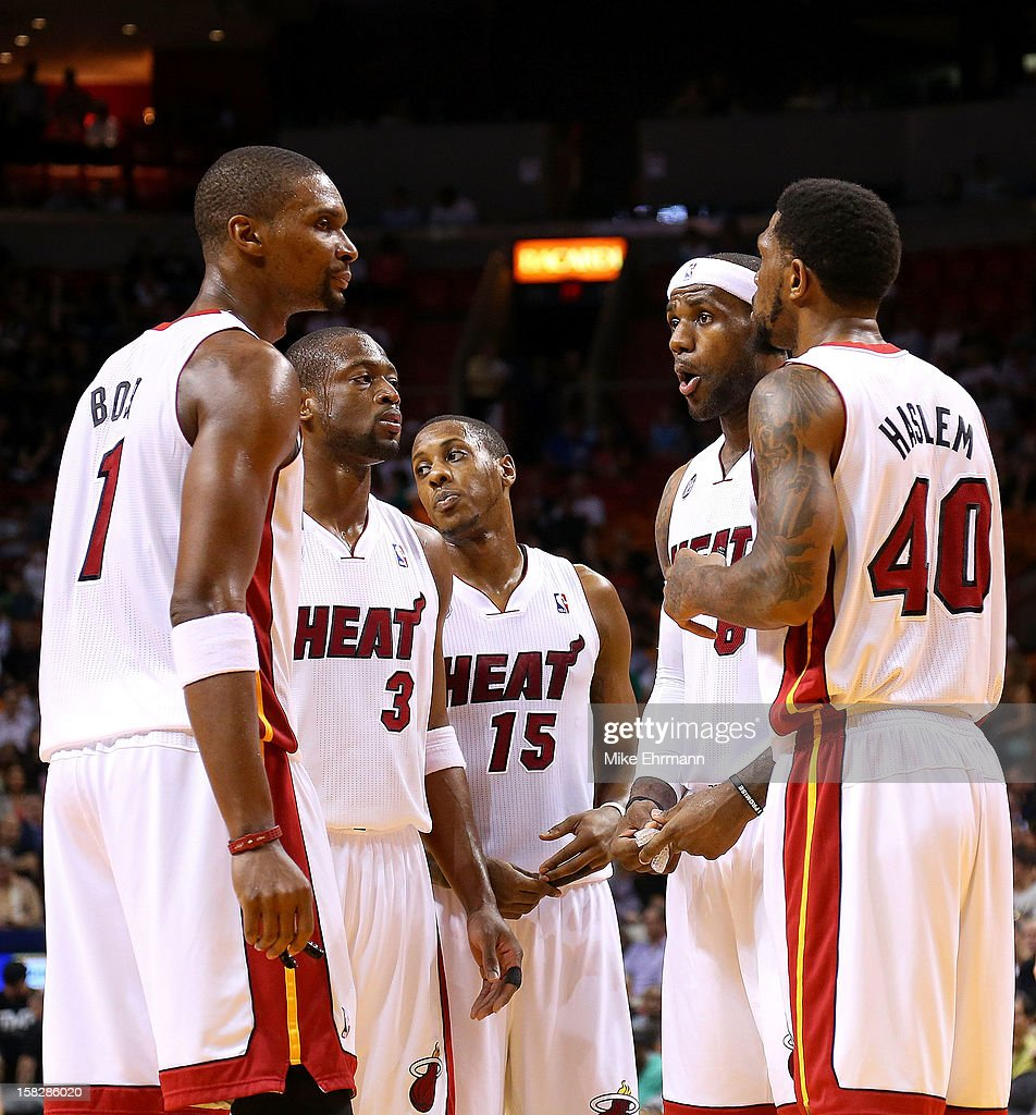 LeBron James #6 of the Miami Heat talks with Dwyane Wade #3, Chris Bosh #1, Mario Chalmers #15 and Udonis Haslem #40 during a game against the Golden State Warriors at American Airlines Arena on December 12, 2012 in Miami, Florida.