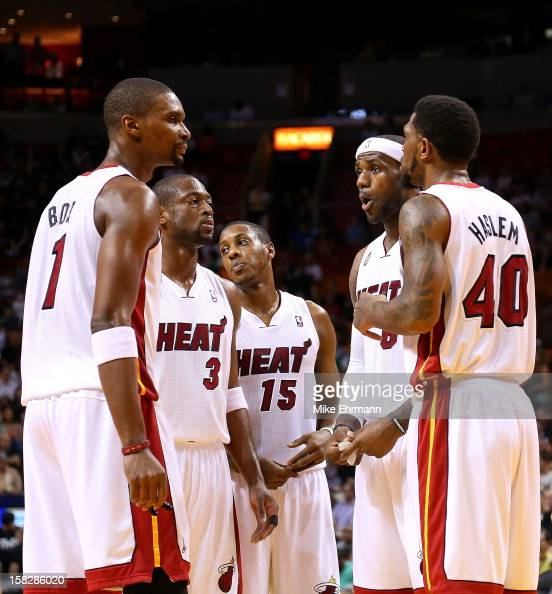 LeBron James of the Miami Heat talks with Dwyane Wade Chris Bosh Mario Chalmers and Udonis Haslem during a game against the Golden State Warriors at...