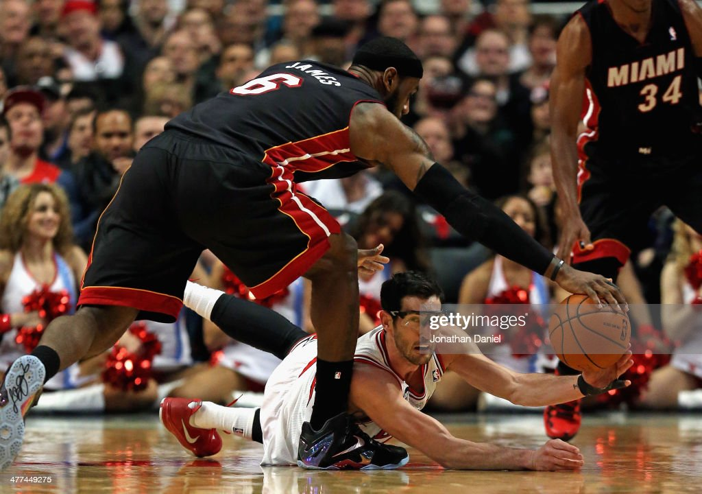 <a gi-track='captionPersonalityLinkClicked' href=/galleries/search?phrase=LeBron+James&family=editorial&specificpeople=201474 ng-click='$event.stopPropagation()'>LeBron James</a> #6 of the Miami Heat tries to knock the ball away from <a gi-track='captionPersonalityLinkClicked' href=/galleries/search?phrase=Kirk+Hinrich&family=editorial&specificpeople=201629 ng-click='$event.stopPropagation()'>Kirk Hinrich</a> #12 of the Chicago Bulls at the United Center on March 9, 2014 in Chicago, Illinois.