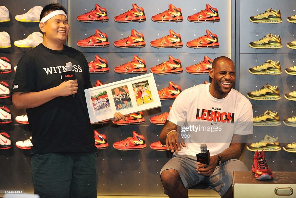 LeBron James (R) of the Miami Heat visits a Nike store on July 25, 2013 in Guangzhou, China.