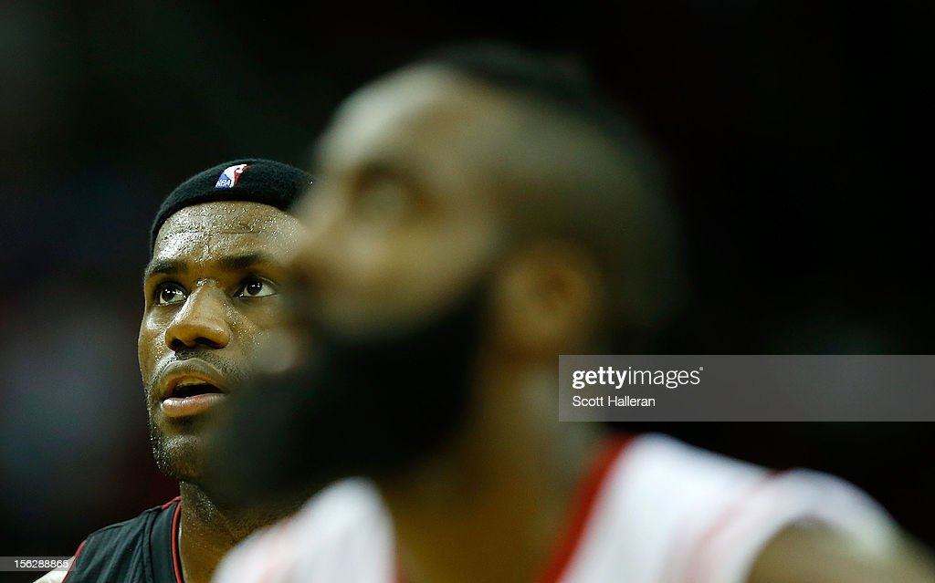<a gi-track='captionPersonalityLinkClicked' href=/galleries/search?phrase=LeBron+James&family=editorial&specificpeople=201474 ng-click='$event.stopPropagation()'>LeBron James</a> #6 of the Miami Heat (L) waits alongside <a gi-track='captionPersonalityLinkClicked' href=/galleries/search?phrase=James+Harden&family=editorial&specificpeople=4215938 ng-click='$event.stopPropagation()'>James Harden</a> #13 of the Houston Rockets at the Toyota Center on November 12, 2012 in Houston, Texas.