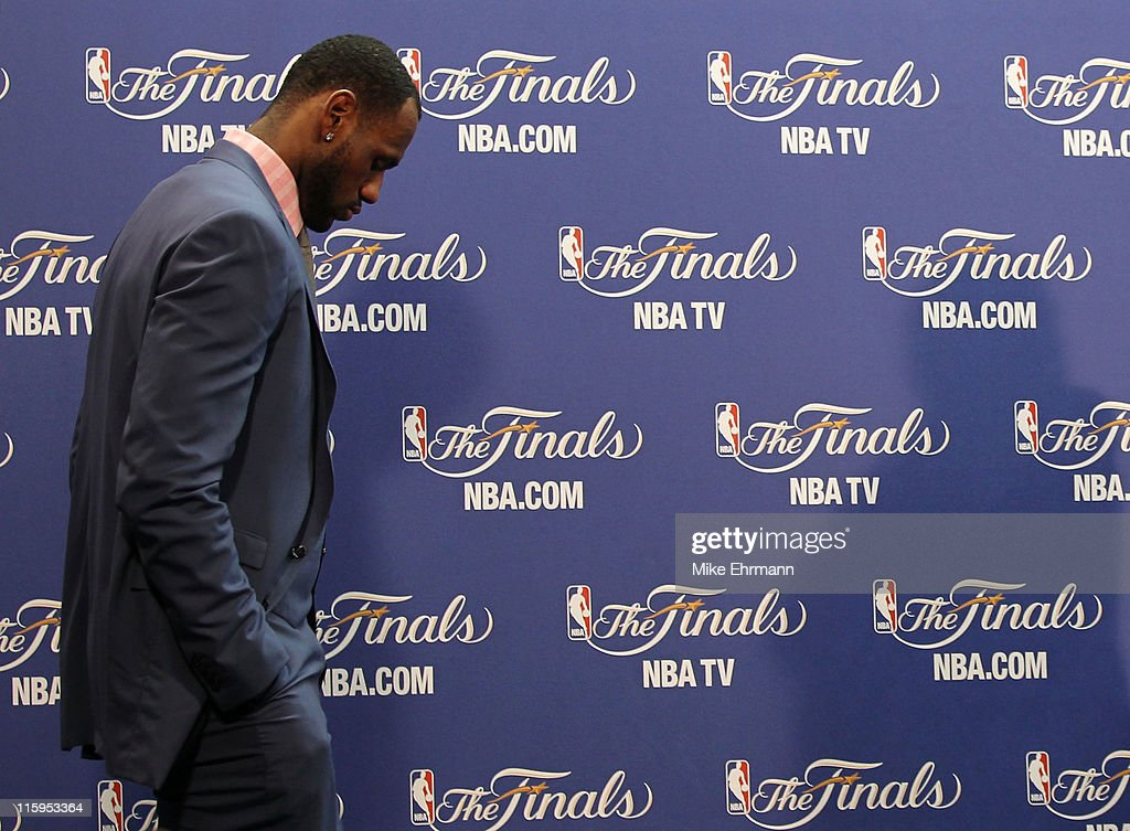 <a gi-track='captionPersonalityLinkClicked' href=/galleries/search?phrase=LeBron+James&family=editorial&specificpeople=201474 ng-click='$event.stopPropagation()'>LeBron James</a> #6 of the Miami Heat walks into the interview room to answer questions after the Heat were defeated 105-95 by the Dallas Mavericks in Game Six of the 2011 NBA Finals at American Airlines Arena on June 12, 2011 in Miami, Florida.