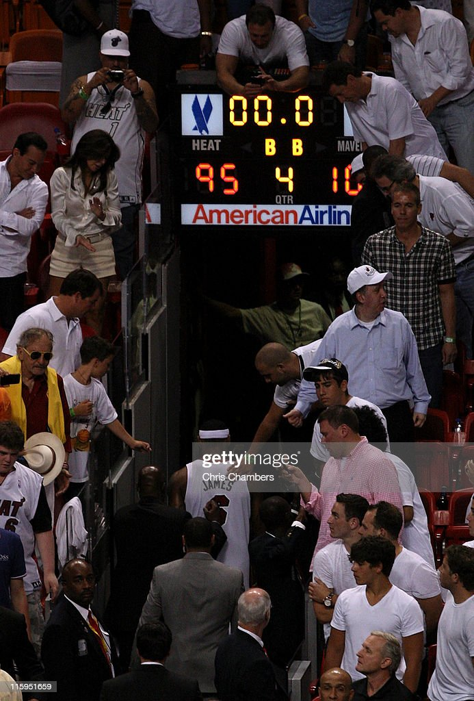 <a gi-track='captionPersonalityLinkClicked' href=/galleries/search?phrase=LeBron+James&family=editorial&specificpeople=201474 ng-click='$event.stopPropagation()'>LeBron James</a> #6 of the Miami Heat walks off the court after the Dallas Mavericks won 105-95 in Game Six of the 2011 NBA Finals at American Airlines Arena on June 12, 2011 in Miami, Florida.