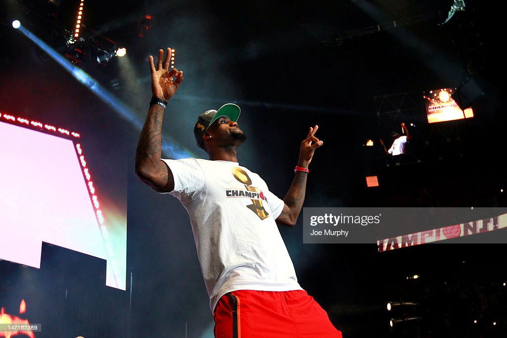 <a gi-track='captionPersonalityLinkClicked' href=/galleries/search?phrase=LeBron+James&family=editorial&specificpeople=201474 ng-click='$event.stopPropagation()'>LeBron James</a> #6 of the Miami Heat waves to the crowd during a rally for the 2012 NBA Champions Miami Heat on June 25, 2012 at American Airlines Arena in Miami, Florida.