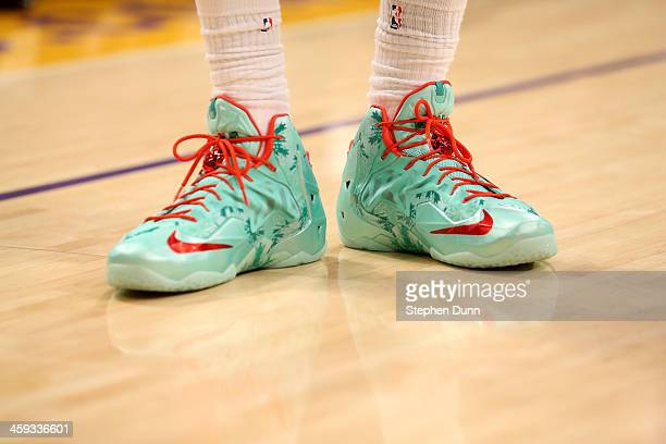 Lebron James of the Miami Heat wears his special Christmas Nike shoes in the game against the Los Angeles Lakers at Staples Center on December 25...