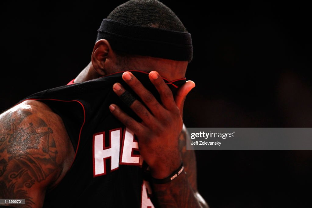 <a gi-track='captionPersonalityLinkClicked' href=/galleries/search?phrase=LeBron+James&family=editorial&specificpeople=201474 ng-click='$event.stopPropagation()'>LeBron James</a> #6 of the Miami Heat wipes his face with his jersey in the first half against the New York Knicks in Game Four of the Eastern Conference Quarterfinals in the 2012 NBA Playoffs on May 6, 2012 at Madison Square Garden in New York City.