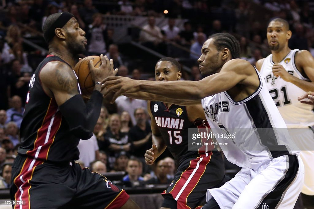 LeBron James #6 of the Miami Heat with the ball against Kawhi Leonard #2 of the San Antonio Spurs in the first quarter during Game Four of the 2013 NBA Finals at the AT&T Center on June 13, 2013 in San Antonio, Texas.