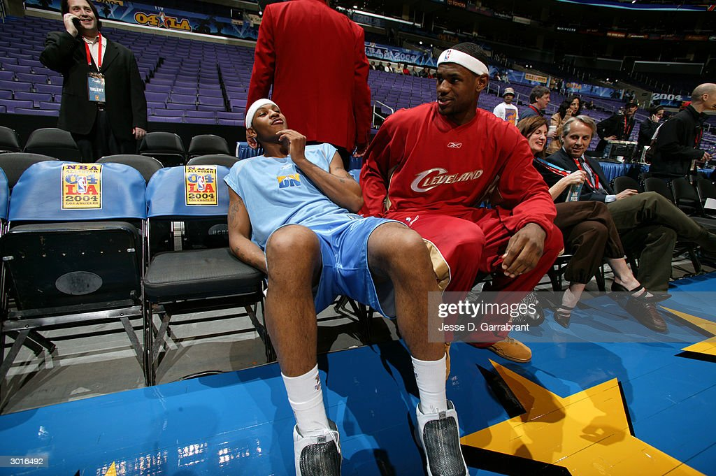 LeBron James of the Rookie Team talks to fellow rookie Carmelo Anthony before they challenged the Sophomore Team in the 2004 NBA Rookie Challenge...