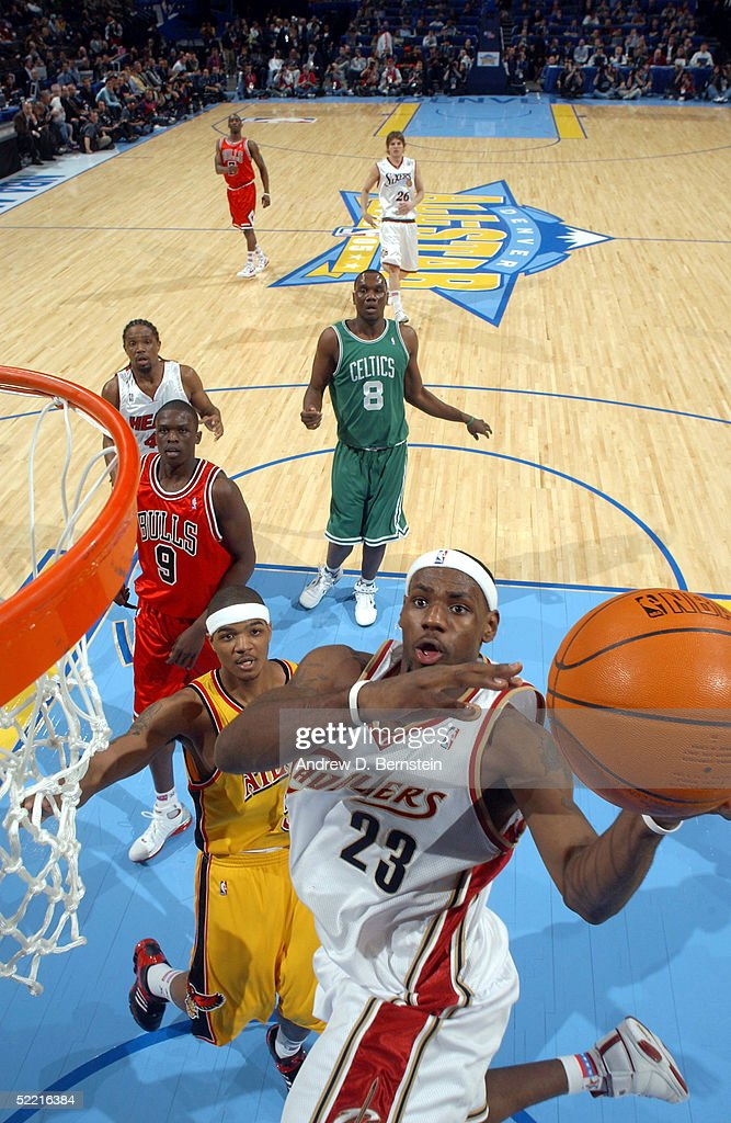 LeBron James of the Sophmore Team drives to the basket past Josh Smith of the Rookie Team in the got milk Rookie Challenge during 2005 NBA AllStar...