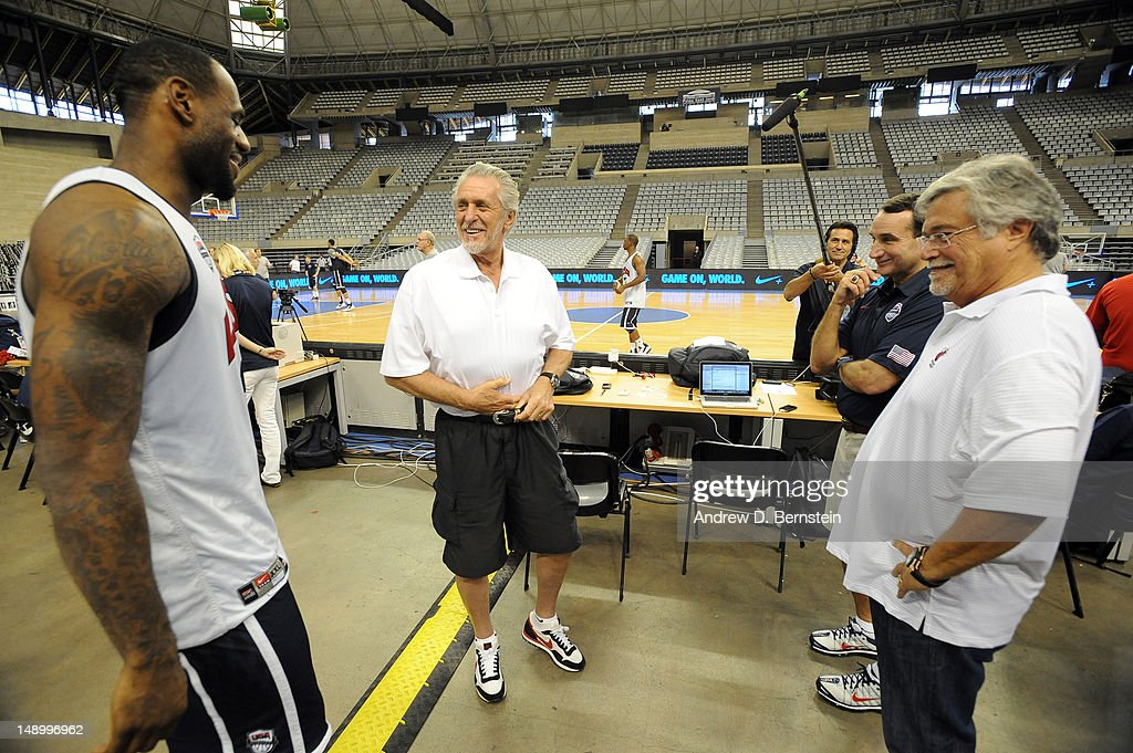 Lebron James of the US Men's Senior National Team converses with Miami Heat President Pat RIley and Heat Owner Micky Arison after practice on July 21, 2012 at Palau Sant Jordi in Barcelona, Spain.
